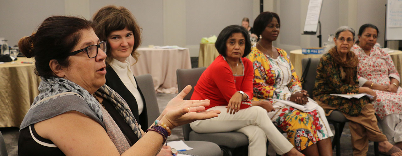 Members of Women Mediators across the Commonwealth talking together during a meeting