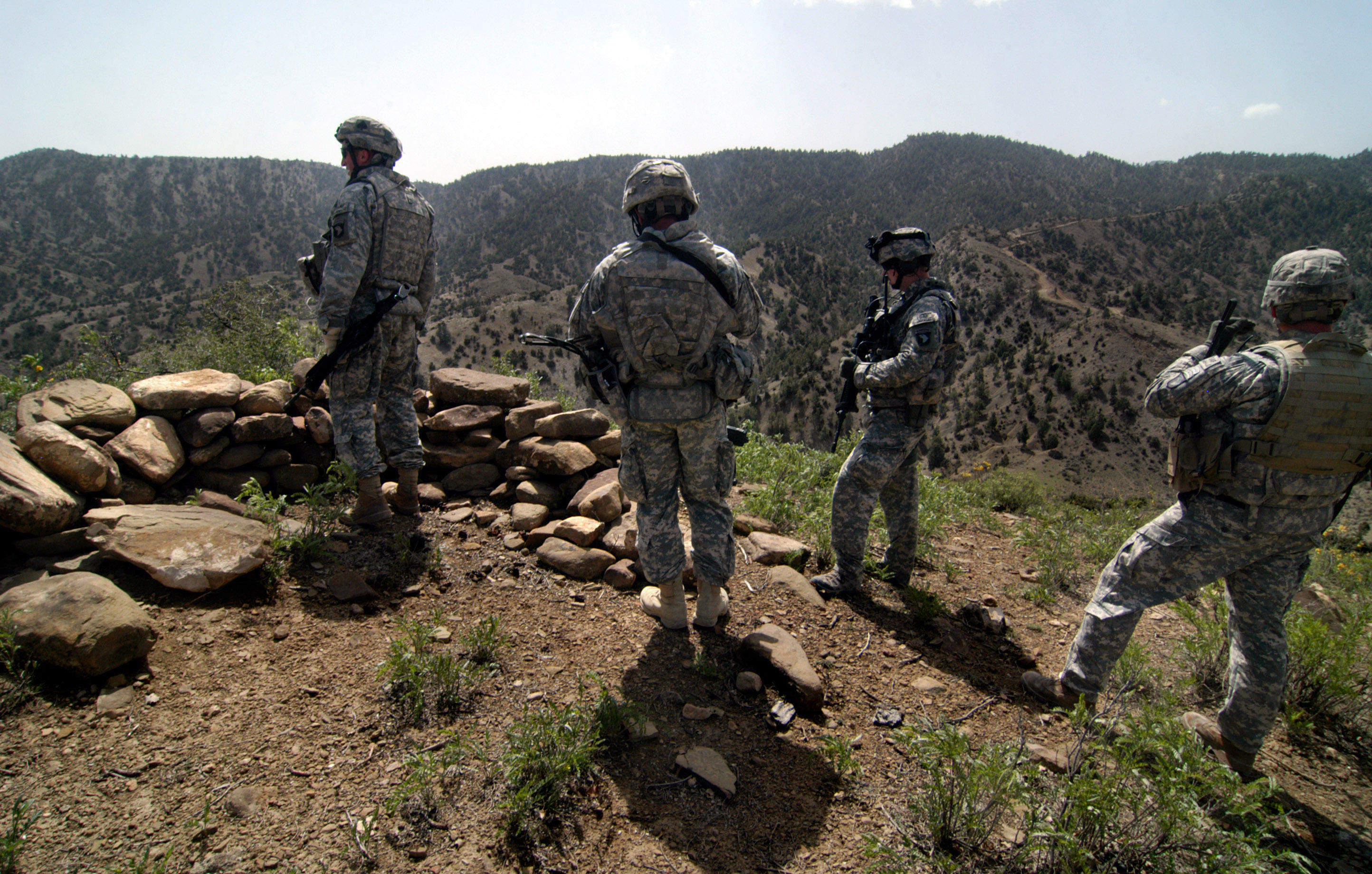US soldiers investigate an insurgent fighting position.