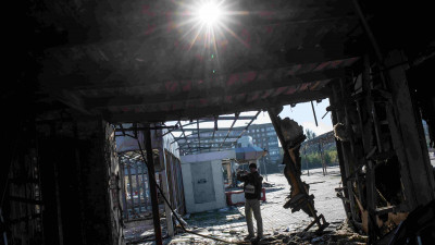 OSCE Special Monitoring Mission to Ukraine monitors making site impact assessment.