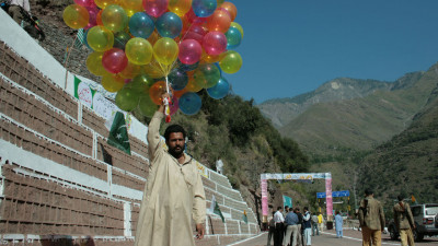 Chakothi, a Kashmiri from LOC west holds a big bunch of colourful balloons, waiting for the Truck Service inauguration reception.