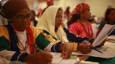 Women review documents at discussion of the Mindanao peace process