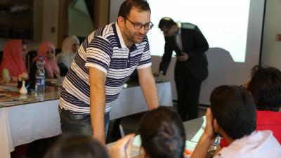 Photo of Waleed Khan at a workshop