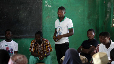 young peacebuilders at a meeting in Liberia