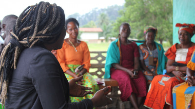 Women peacebuilders from Kenya and Liberia talking to each other