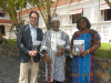 Blomah Nelson, Liberia's Minister for Internal Affairs (centre), pictured with Jonathan Cohen and Janet Adama Mohammed of Conciliation Resources