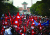 Demonstrators carrying the national flag of Nepal participate in a mass gathering demanding peace, social harmony and the punctual implementation of a new constitution in Kathmandu, 23 May 2012