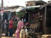 Market woman carrying load - Gada Biyu market, Jos, Nigeria