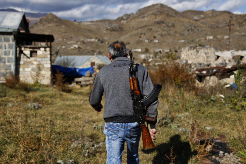 A soldier back from the frontlines around Shushi returns to his house to pack up and escape Kalbachar, Nagorny Karabakh. Credit: Jack Losh