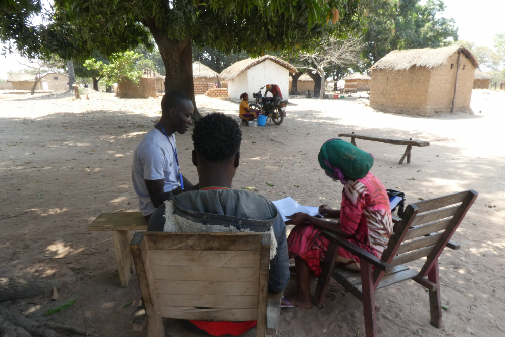 Researchers listening to a young man in a rural commune around Paoua