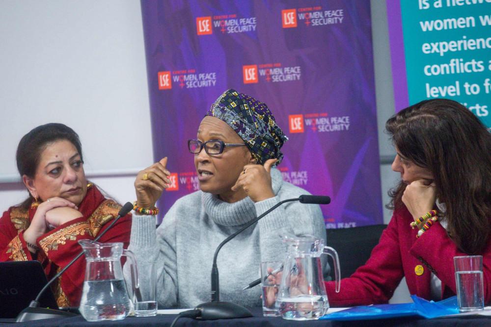 Women peacebuilders speaking at a women mediators event