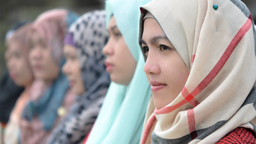 A line of young muslim women in the Philippines